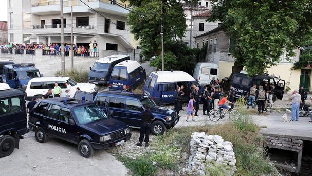 Albanian special forces police surround the marijuana-growing village of Lazarat (AP)