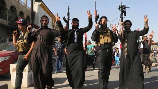Shiite tribal fighters chant slogans against the al Qaida-inspired Islamic State of Iraq and the Levant (ISIL) in Baghdad (AP)