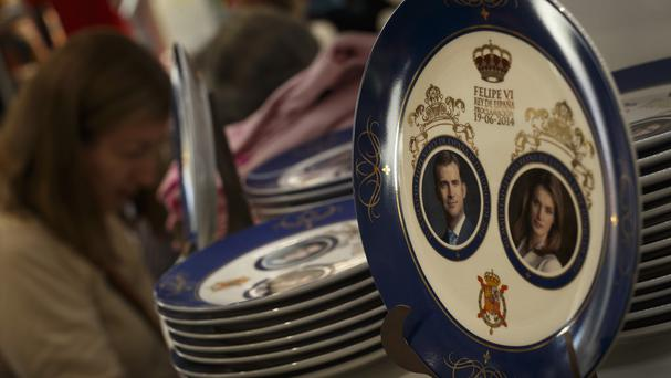 Souvenirs depicting Spanish Crown Prince Felipe and his wife Princess Letizia, in Madrid (AP)