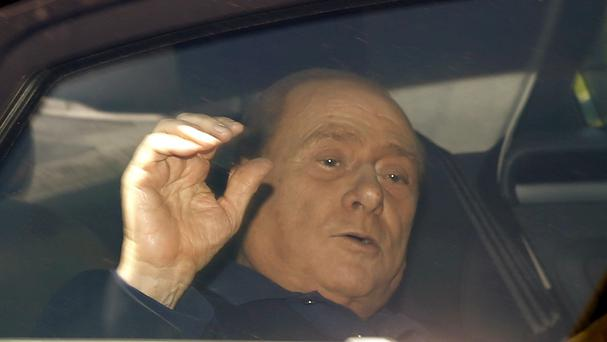 Silvio Berlusconi leaves the Sacra Famiglia community where he is doing community service work as part of a tax fraud sentence (AP/Luca Bruno)