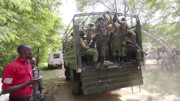 A truck loaded with Kenyan security troops patrols in Mpeketoni town (AP)