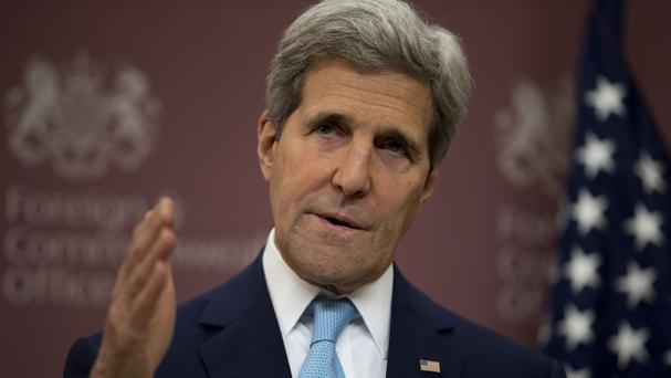 John Kerry lands in Baghdad to press Iraqi leaders as insurgency spreads