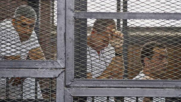 The defendants during their trial on terror charges in a courtroom in Cairo (AP)