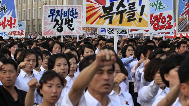 Pyongyang citizens march through Kim Il Sung Square (AP)