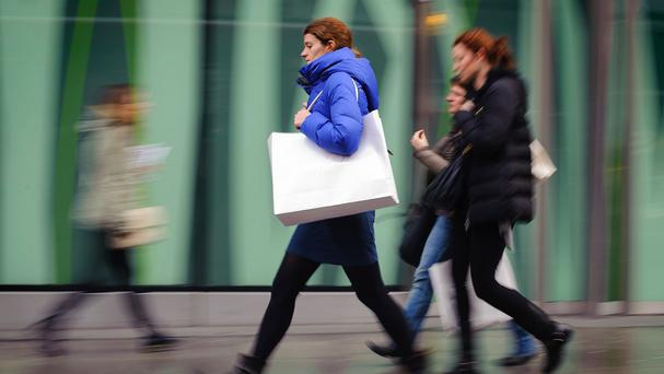Economists said the severe winter kept Americans away from the shops and car dealers