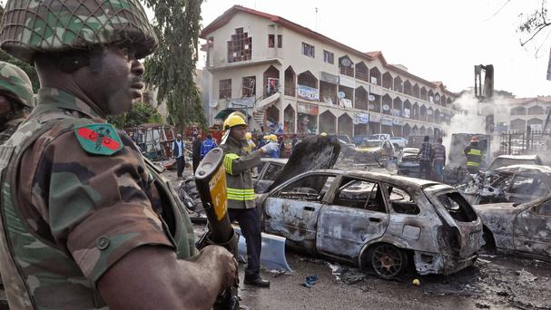 The scene of the explosion in Abuja, Nigeria (AP)