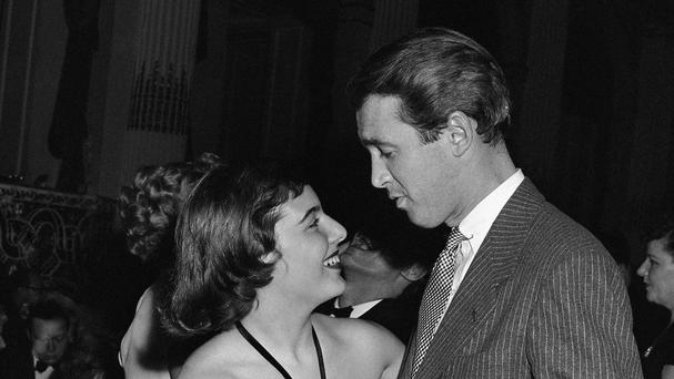 Film star Jimmy Stewart dances with Mary Rodgers in New York in 1943 - she has died at the age of 83 (AP)