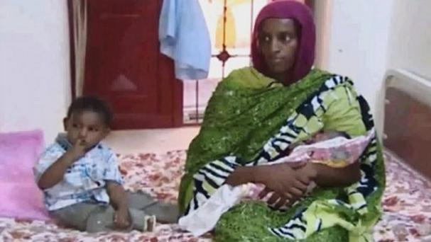 Meriam Ibrahim last night left a Khartoum police station where she had been detained with her two children and husband (AP/Al Fajer)