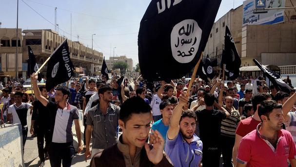 Demonstrators support Islamic State of Iraq and the Levant in Mosul (AP)