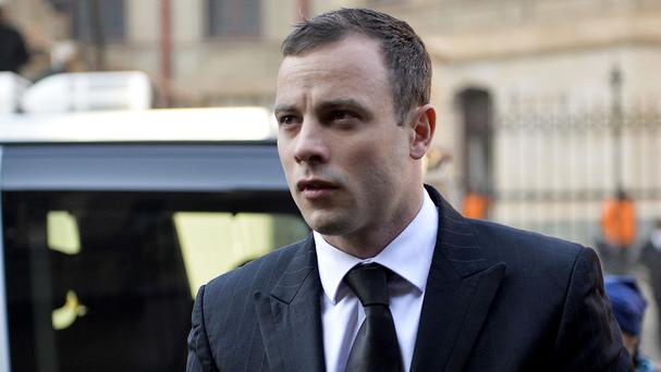 Oscar Pistroius arrives at court in Pretoria as his murder trial resumes after a month of mental health evaluation (AP)