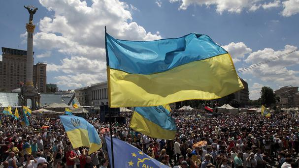 People gather for a rally in Independence Square in Kiev, Ukraine, against the ceasefire (AP)