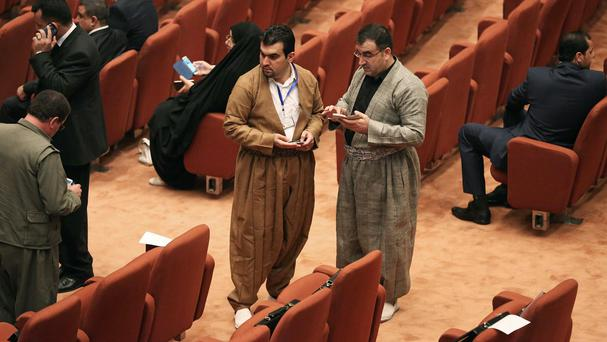 Newly elected Iraqi Kurd members of parliament attend the first session in the heavily fortified Green Zone in Baghdad (AP)