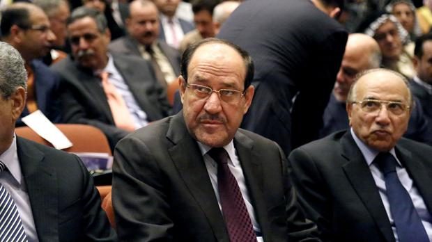 Nouri al-Maliki warned an extremist group's declaration of an Islamic state is a threat to the entire region (AP)