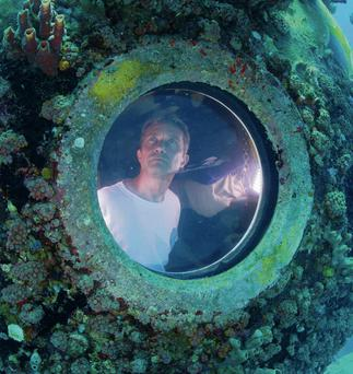 Fabien Cousteau is pictured on his first dive outside the marine laboratory Aquarius