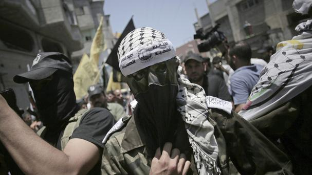 A masked militant during the funeral of two Fatah militants killed by an Israeli airstrike, in Bureij refugee camp, central Gaza Strip (AP)