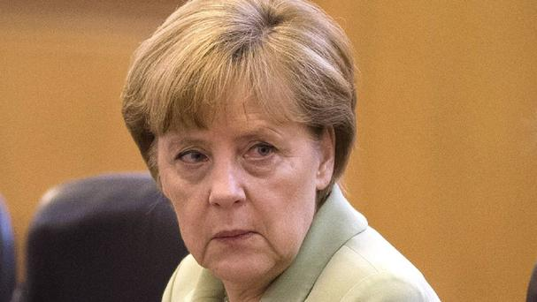 Angela Merkel has made her first public remarks on the arrest of a man suspected of spying for foreign intelligence services (AP)