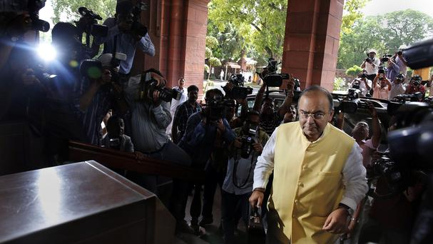 Indian finance minister Arun Jaitley arrives to present the 2014-15 union budget at the Indian parliament in New Delhi (AP)