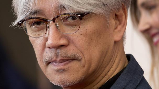 Ryuichi Sakamoto has revealed he is suffering from throat cancer (AP)