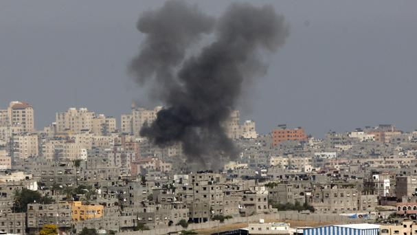 Smoke rises following an Israeli strike on Gaza (AP/Lefteris Pitarakis)
