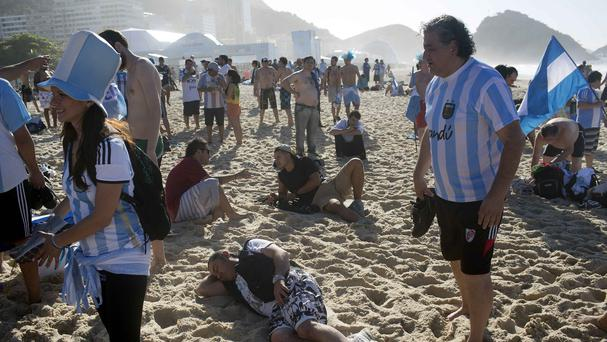 Some Argentina soccer fans spent the night on Copacabana Beach in Rio de Janeiro (AP)