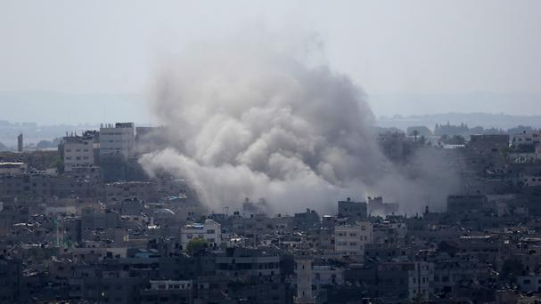Smoke rises after an Israeli missile strike in Gaza City (AP)