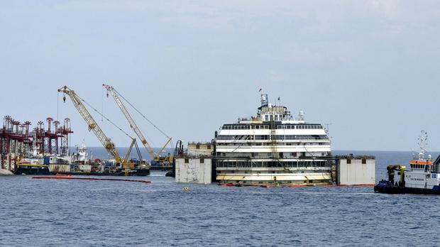 The luxury cruise ship Costa Concordia is seen at the beginning of the operations to put it afloat, on the tiny Tuscan island of Giglio, Italy (AP)