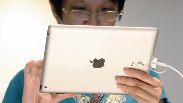 iPads and other other electronic devices containing nickel might cause rashes, say doctors (AP)