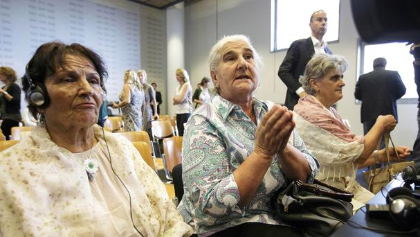 Women from the Bosnian town of Srebrenica wait for judges to enter a civil court in The Hague (AP)