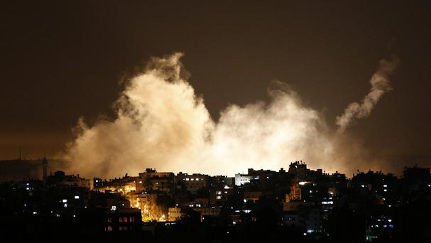Smoke from flares rises in the sky in Gaza City as Israel launches a large-scale ground offensive (AP)