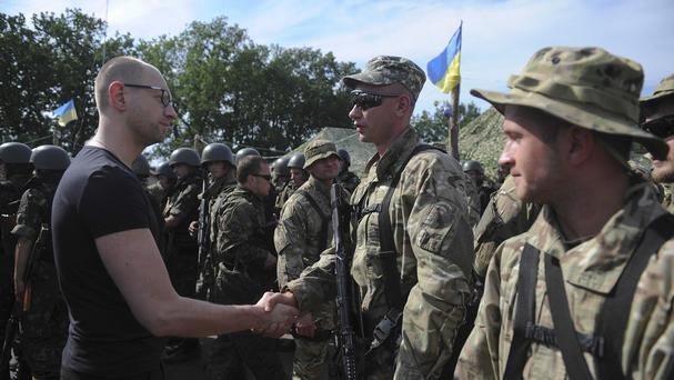 Ukrainian prime minister Arseniy Yatsenyuk meets soldiers outside the eastern town of Slovyansk (AP/Andrew Kravchenko)