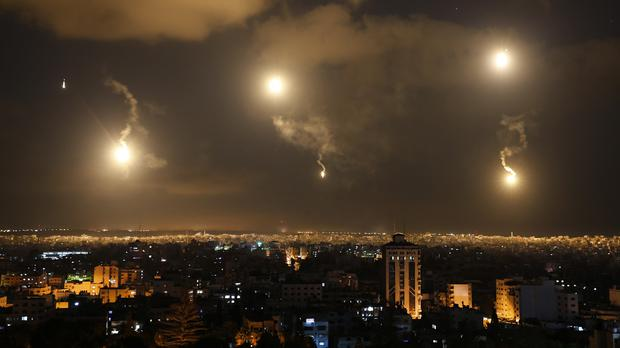 The sky and the city is lit by Israeli forces' flares in the northern Gaza Strip (AP)