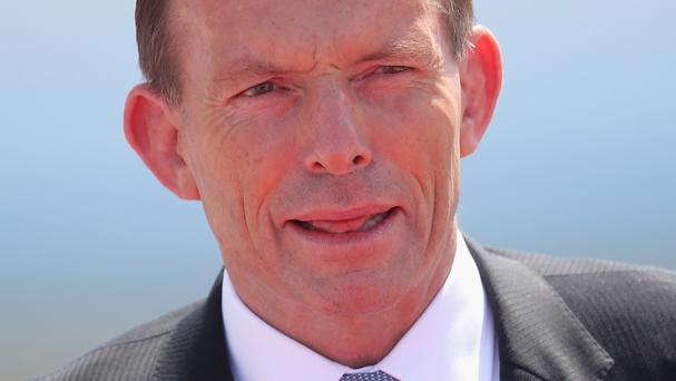 Tony Abbott has condemned Russia's response to the plane crash as