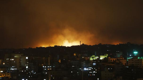 Smoke from flares fired by Israeli forces rise in the sky in Gaza City (AP)