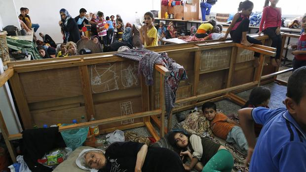Palestinians seek refuge at a United Nations school after fleeing their homes in Beit Hanoun, in the northern Gaza Strip (AP)