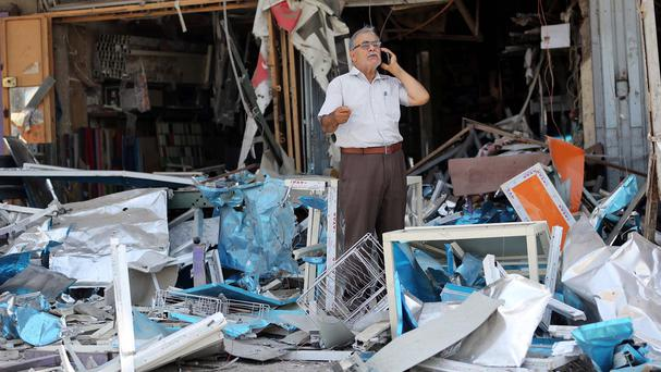 A series of bombings also hit Baghdad on Saturday, leaving dozens of people dead and injured (AP)