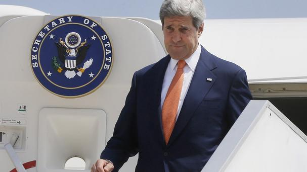 John Kerry arrives in Tel Aviv to pursue efforts for a ceasefire between Hamas and Israel (AP)