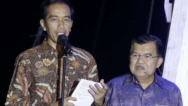 Indonesian president-elect Joko Widodo, left, delivers his victory speech as vice president-elect Jusuf Kalla listens on in Jakarta (AP)