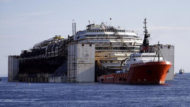 The wreck of the Costa Concordia is being towed to the Italian port of Genoa, where it will be scrapped (AP/Gregorio Borgia)