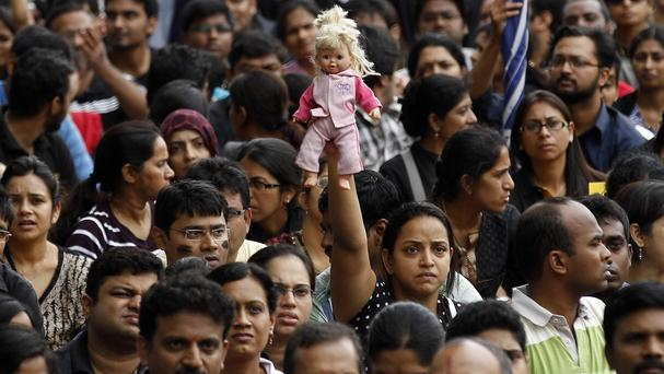 Thousands protest against alleged police inaction after a six-year-old was raped at a school in Bangalore, India (AP/Aijaz Rahi)