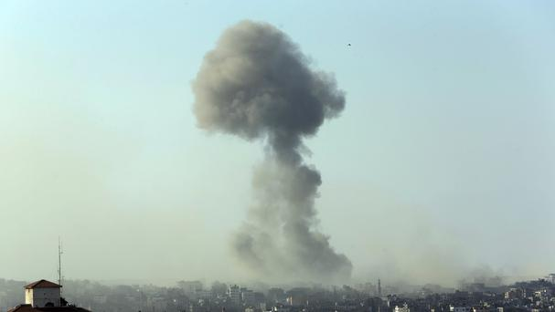 Smoke from an Israeli strike rises in the air over Gaza City (AP)