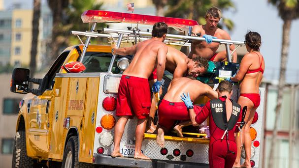 Lifeguards assist a person who was in the water and apparently struck by lightning (AP)