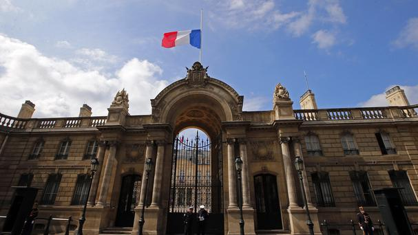 A half staff French flag flies at the Elysee Palace in Paris, France. (AP Photo/Francois Mori )