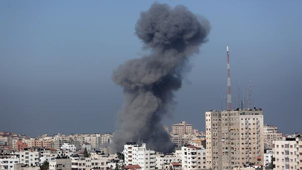 Smoke from the explosion of an Israeli strike rises over Gaza City. (AP)