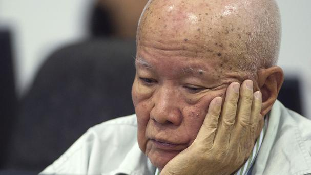 Former Khmer Rouge head of state Khieu Samphan sits in the courtroom during a hearing at the UN-backed war crimes tribunal in Phnom Penh (AP Photo/Extraordinary Chambers in the Courts of Cambodia)