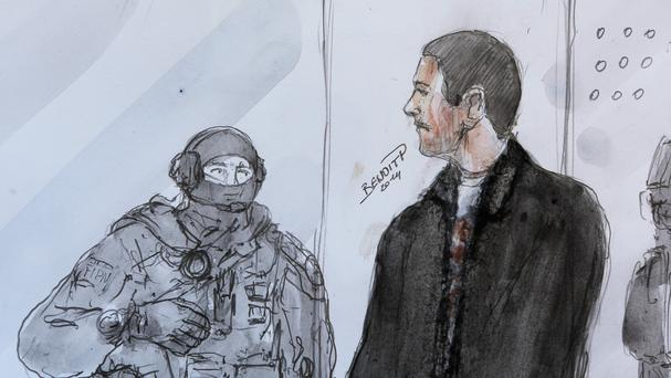 An artist's sketch depicts Mehdi Nemmouche, right, as he stands next to a police agent during his court appearance at Versailles Court of Appeal. (AP)