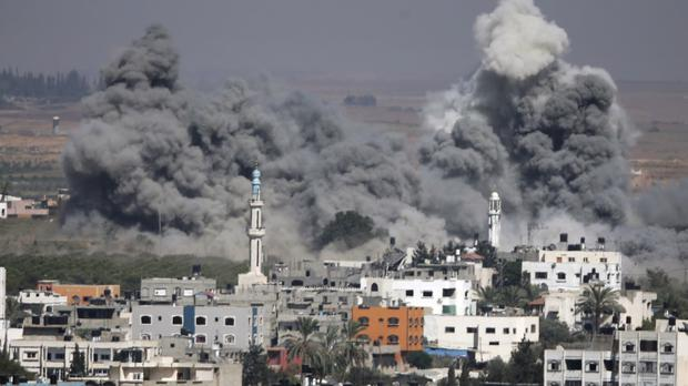 Smoke rises after another Israeli strike in Gaza City. (AP)