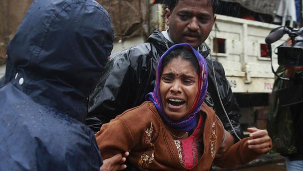 Many people have lost their relatives to the landslide in Malin village. (AP Photo/Rafiq Maqbool)
