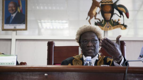 A judge reads the verdict at Uganda's Constitutional Court, which ruled that an anti-gay law had been passed illegally. (AP Photo/Rebecca Vassie)