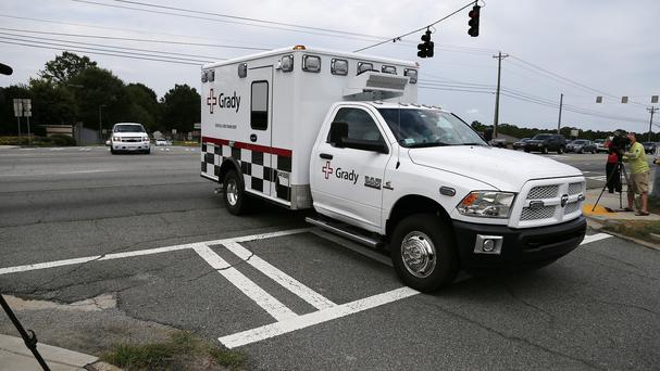An American who was infected with the Ebola virus has been transported by ambulance to an Atlanta hospital