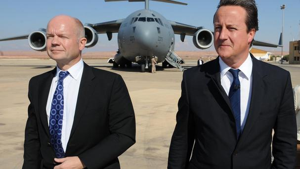 Prime Minister David Cameron (right) and William Hague at Tripoli Airport during a visit in 2011